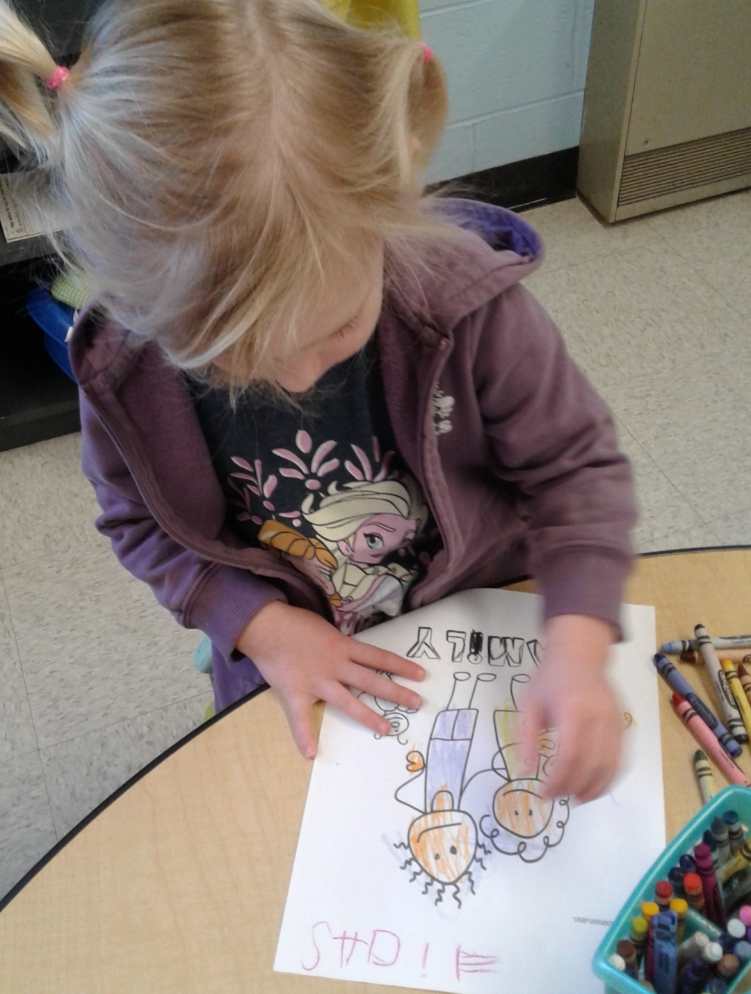 Child colouring a picture