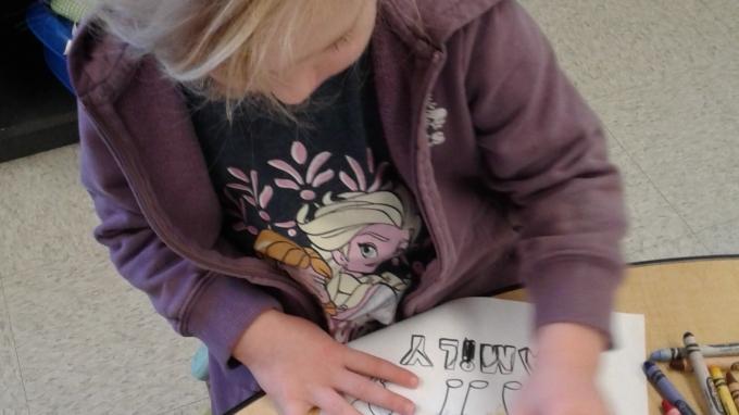 Child colouring a picture